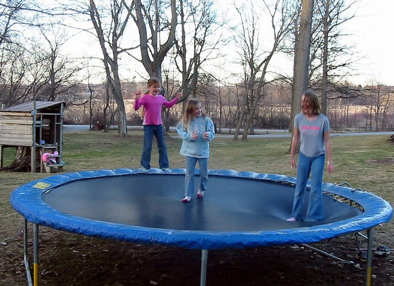 playing on a trampoline with family